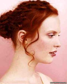 This loose updo, fashioned by New York City stylist Nathaniel Hawkins, is modern and sophisticated. He applied mousse to wet hair, blew it dry, and tied knots along 1-inch sections. Strands were pulled back into a ponytail, which was wrapped around base, pinned, and sprayed.