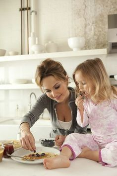Found a way to do what she loves and be with her daughter too! And a great business woman !    Cooking mother/daughter style. Giada De Laurentis and her daughter, Jade. Photo: Amy Neunsinger