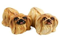 Pekinese Handmade Salt and Pepper Shaker (5cm x 5cm) by Blue Witch. $48.00. Individually handmade and hand painted. Salt and Pepper Pair. Genuine Blue Witch Ceramic Product. Product Dimensions : 5cm x 5cm. The Pekinese or 'Pekingese' is an ancient breed of toy dog from China, where it was the favoured by the Chinese Imperial Court who considered it a guardian spirit. Beautifully brought to life on this hand painted original cruet set.