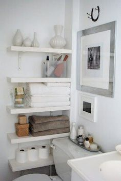 White bathroom + small bathroom storage - on wall with crates