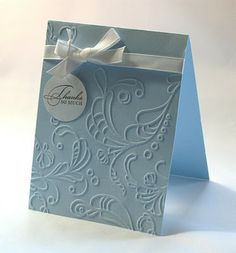 Elegant and simple. Just need a Cuttlebug embossing folder, white satin ribbon, a tag, a stamp and a bit of string. LOVE IT!