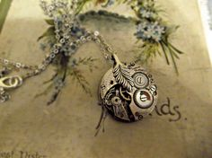 This is a classic and wearable design, made using a stunning 1930s watch mechanism and a simple leaf connector. The necklace has been placed onto a dainty silver plated bobble chain, which measures approximately 9 in drop. You may not receive the ...
