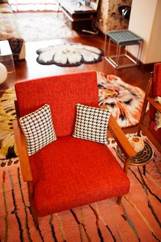Red goes great with houndstooth and an orange rug.
