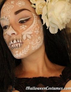 sugar skull makeup - Halloween Costumes, like this idea. little bit of white with the black and colors