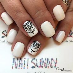 White nails with black dotted nail art
