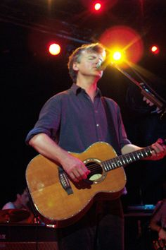 Neil Finn playing his Maton