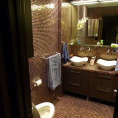 Floor-to-ceiling tile gives this reader's renovation a luxury hotel bathroom feel. | 2013 Reader Remodel Contest | thisoldhouse.com/yourTOH
