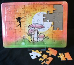 Jigsaw using Clarity stamps and Distress inks.