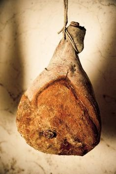 How to Make Tuscan-Style Prosciutto at Home: A prosciutto hanging to cure in a basement