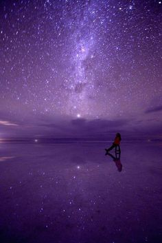Girl sitting & looking at the Milky Way in a Purple sky art