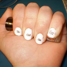 May The Odds...    really easy to do, print of words small enough to fit on your nails on printer paper. paint nails and let dry, then dip in alcohol, put paper on alcoholed nails and hold for 60 secs....and there you have it!