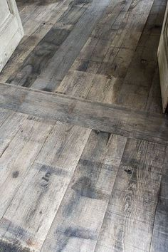 I love this aged look. The color would brighten up a room.---washed wooden floor for kitchen, Maybe just do instead of actual hardwood flooring and use Minwax Gray to give the washed look. I wonder how it would match to living room floors? Wooden Flooring, Kitchen Flooring, Flooring Ideas, Gray Wooden Floors, Basement Flooring, Bedroom Flooring, Hardwood Floors Wide Plank, White Wash Wood Floors, Distressed Hardwood Floors
