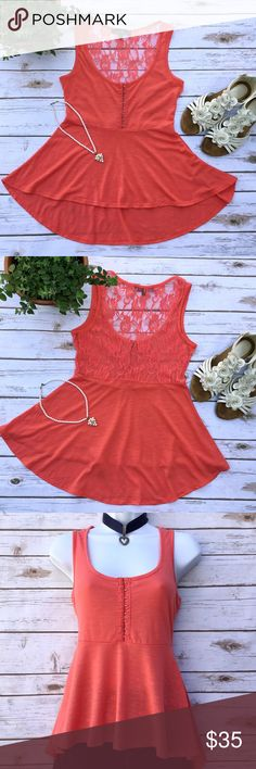 Almost Famous Hi-Lo Peplum Top with Lace Back Just adorable! Beautiful coral color, has hook and eye closure in the front and lace in back. I believe the lace is 65% polyester and 35% rayon, the body consists of 92% nylon and 8% spandex, allowing for a little stretch. Size S, measures 15.5 inches across from armpit to armpit; length in front is about 22.5 inches, in back it reaches down to 27 inches. Almost Famous Tops Tank Tops