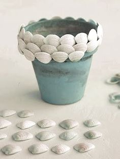 Decorating pots with shells doesn't get any easier than this. Maryann created a cute Shell Pot by simply adding a shell trim.