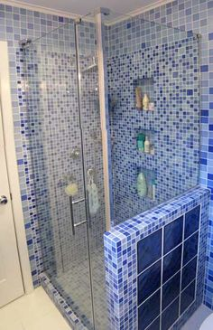 forget the colours shapes of tileswhat about the half wall for the walkin master en suite rather than a full wall glass tile mosaic bathroom