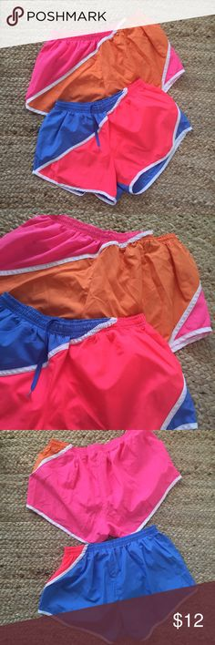 Set of 2 Throwback Pony Shorts Bright vintage vibe in these awesome track shorts by Pony! Soft, lightweight, moisture-wicking fabric. Built-in liner with small hidden pocket and drawstring waist. Roomy legs. Fits slightly small (between a medium and a large). In great condition! Pony Shorts