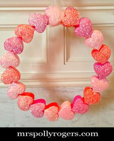 Click here to DIY Dollar Tree Heart Box Valentine Wreath.  I got these heart boxes today--you'll want to run get them, too, since they are 10 for a dollar!  Blog instructions from MrsPollyRogers.com