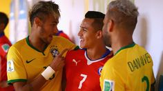 Neymar (L), Dani Alves (R) of Brazil greet Alexis Sanchez (C) of Chile in the tunnel