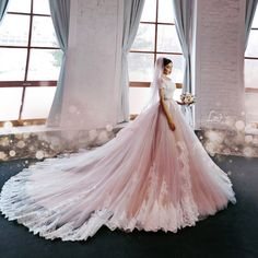 Can't take our eyes off this beautiful bridal portrait featuring a romantic pink laced gown!