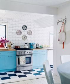 White is huge for kitchens right now: white appliances, white countertops, and especially white cabinets. It's a clean, uniform, and refreshing look — but it's not for everyone. If you find yourself craving a little color in the kitchen, take a look at this roundup of 11 kitchens with cabinets in any color but white. If you love the look, it can be as close as a paint job away.