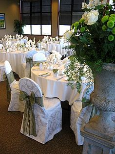 Ivory damask chair covers with sage organza sash at Heritage Pointe Golf Course.
