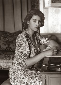 Queen (then Princess) Elizabeth photographed while writing at her desk in 1944
