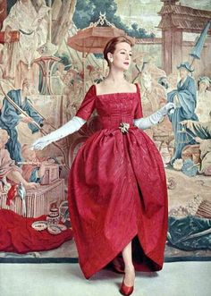 Model wearing a red moire Balenciaga evening gown, 1956.