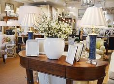 Top those side tables with frames, lamps, and ceramics from @kelloggfurn
