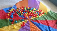 "Popcorn Promise Game for Orange ""Responsibility"" Petal.  Kids play game of "" popcorn"" using parachute to bounce balls out and all over the room, then have them ""promise to pick up a certain number and color balls until all is clean.   OCD Girl Scout Leaders"