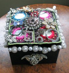 Make trinket box decorated with brooches, earrings, etc.  Could work for larger jewelry box, too.