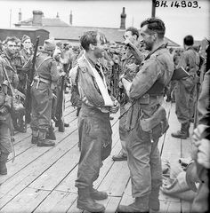 Royal Marine Comando Major Len Coulson (talking to man with sling) and the men who took part in the raid on Dieppe, France, 19 August 1942