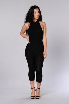 - Available in Sage and Black - Ribbed Jumpsuit - Halter Neckline - Cropped Length - Open Back - Made in USA - 48% Rayon 48% Polyester 4% Spandex