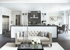 love a tufted sofa in this open kitchen / living space. transitional living room by Linda McDougald Design | Postcard from Paris Home