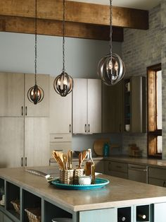 Several small, rustic pendants work well over a kitchen island