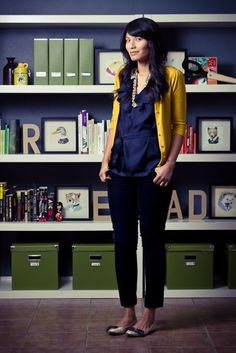 Outfit is cute, but love the bookshelf behind her. READ