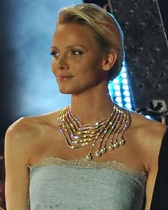 Princess Charlene of Monaco wears her diamond and pearl cascade necklace. The necklace is made of 18K Rose gold and is set with diamonds and pearls; 1,237 white, round and baguette shaped diamonds; and 6 pear-shaped white pearls.
