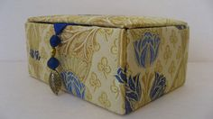 Fabulous gold brocatelle silk jewelry box in a rich gold color with a floral design in pale blue and bright blue. Lined with a bright blue dupioni
