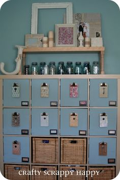 This is one idea for changing an Ikea bookshelf by adding doors. LOVE because you can paint the doors any color and combine with baskets where you like :o) craft room ideas