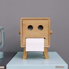 We adore the cute face of this little robot toilet paper roll holder. Handmade from bamboo this sturdy and well-finished box will add fun and chic to your bathroom. Easy opening with a secure catch. Material: Bamboo Size: 16 x 16 x 22 cm/ x x in Tissue Box Covers, Tissue Boxes, Wooden Toilet Paper Holder, Toilet Roll Holder Wood, Paper Roll Holders, Covered Boxes, Wooden Diy, Decoration, Wood Crafts