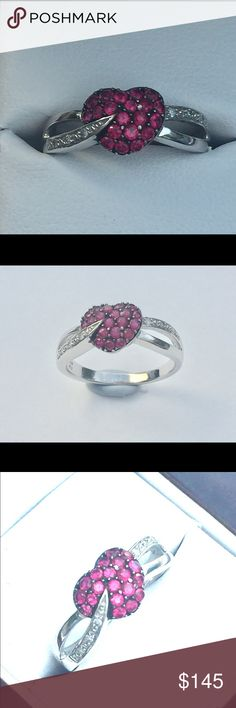 NWT, 10 kt white gold, ruby heart with diamonds What a captivating heart! Brand new made by me in my studio.  The red heart is made of very nice lab created rubies, the ring shank simulates a ribbon winding over the heart with genuine diamonds. The setting is 10 kt white gold. I've used only beautiful and top quality materials in this ring. You'll fall in love with this piece. Jewelry Rings
