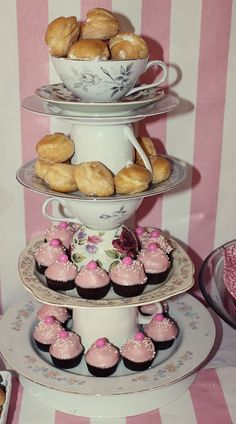 Tiered dessert tray made from teacups and plates/saucers from Goodwill (cost $7)  So pretty & feminine.