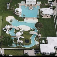"""Now this is a pool! This """"water park"""" was designed by Celine Dion for her Florida home and it's pretty impressive. Florida Mansion, Florida Home, Dream Pools, Celebrity Houses, Celebrity Mansions, Cool Pools, Awesome Pools, House Goals, Pool Designs"""