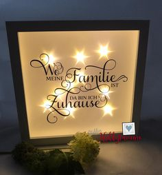 White picture frame with integrated fairy lights and a saying (see photo) on effect foil. This effect foil has