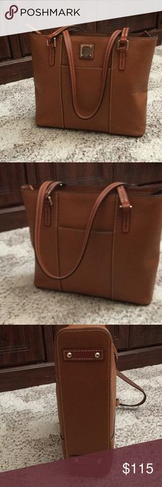 """Dooney Lexington shopper Pebble leather, double straps, metal-plated logo, four bottom feet, top zipper closure, front and back slip pockets Lined interior, two front-wall slip pockets, one back-wall zip pocket, one back-wall slip pocket, key keeper Measures approximately 12""""W x 10-1/4""""H x 3-1/2""""D with an 11"""" strap drop; weighs approximately 1 lb, 9oz Body/trim 100% leather; lining 100% cotton or 65% polyester/35% cotton. Color is caramel Dooney & Bourke Bags Shoulder Bags"""