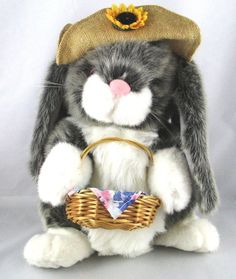 "America Wego Plush Stuffed Bunny Rabbit. Wearing a burlap hat & holding a wicker basket. This is a well cared for plush animal that remains in great condition with minor to no signs of wear. Measures 12"" standing up.  ..... Visit all of our online locations..... www.stores.ebay.com/ourfamilygeneralstore ..... www.bonanza.com/booths/Family_General_Store ..... www.facebook.com/OurFamilyGeneralStore"