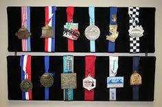 Race medal display @Andrew Mager Meekhof
