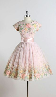 This dress is so pretty. I like the ribbon and the flower design.
