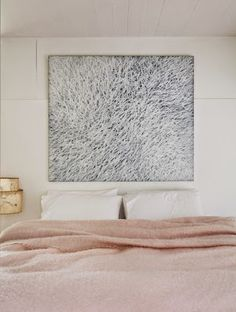 art above bed, warm soft pink paired with cool grey artwork