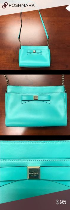 """Kate Spade Tiffany Blue / Teal Crossbody with Bow Kate Spade Tiffany Blue / Teal Crossbody with Bow detail and Shoulder strap. Good condition! But some wear seen in photos. Slight discoloration on stitching and on interior - seen in photos. Genuine leather exterior. Strap drop 19"""" measurements 6.5"""" H x 9.5"""" W x 2.5 D kate spade Bags Crossbody Bags"""