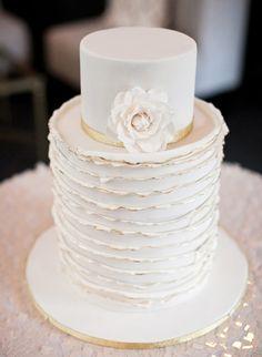 White wedding cake with gold edges.  Photo: Josh Gruetzmacher
